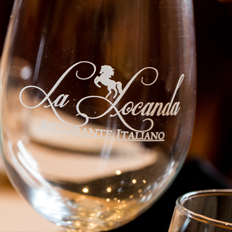 a La Locanda wine glass with frosted text