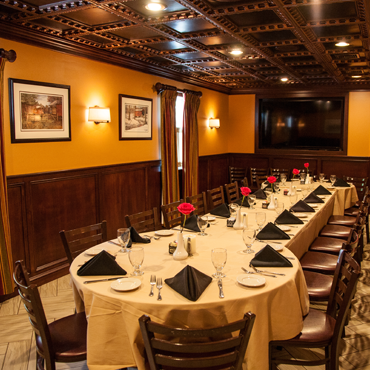 one of our private party rooms that has beautifully wood worked ceilings accompanied by elegant decor