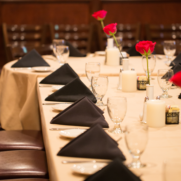 perfectly set table placements on a long table in our private dining room