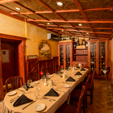 our small private dining room with tin ceilings and amazing woodwork craftsmanship
